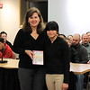 "Vice President Dr. Jane Penman is presented with ""Curious McCarthy's Power of Observation"" by Faith Nonemaker from Andrew G. Curtin Intermediate."