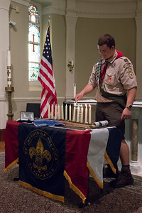 shumskis08-Jacob_lighting_12_candles_to_symbolize_the_tenets_of_Scout_Law