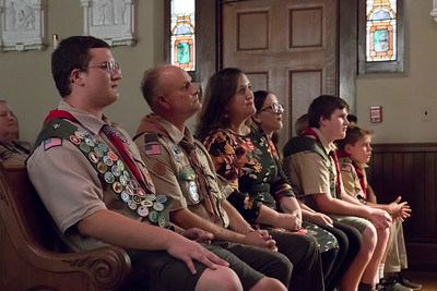 shumskis03-Eagle_Scout_Jacob_Maxham_sitting_next_to_his_family