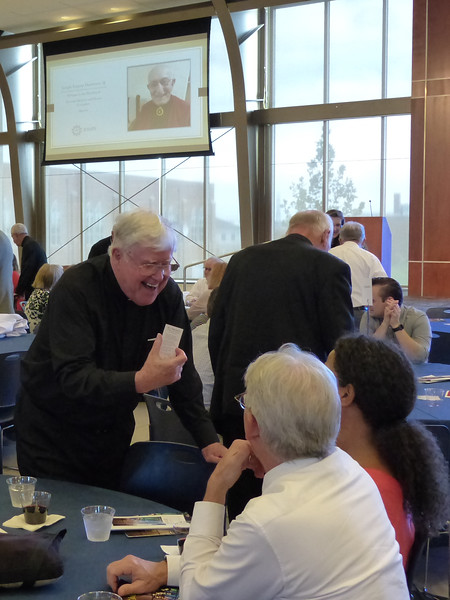 Father Thomas Jost, SJ, shares his Jubilee holy card with friends.