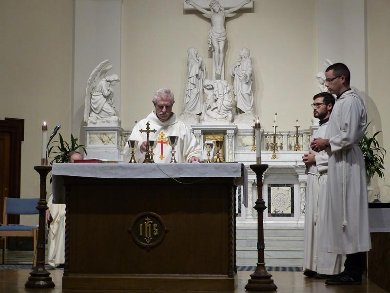 Brother John Fava, SJ, preparing the altar