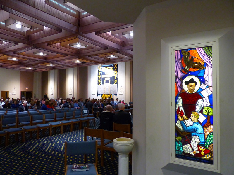 Guests gather in the chapel at St. Louis University High School.