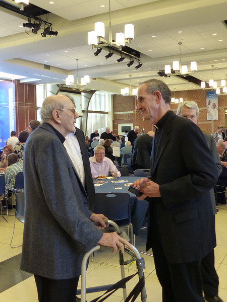 Father Provincial Ron Mercier, SJ, thanks and congratulates Jubilarian Fr. James Short, SJ, for his 70 years of service.