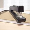 office standard stapler sitting on office desk