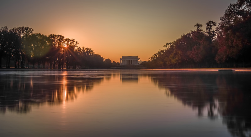 sunset and lincoln memorial reflecting in a pool in washington dc