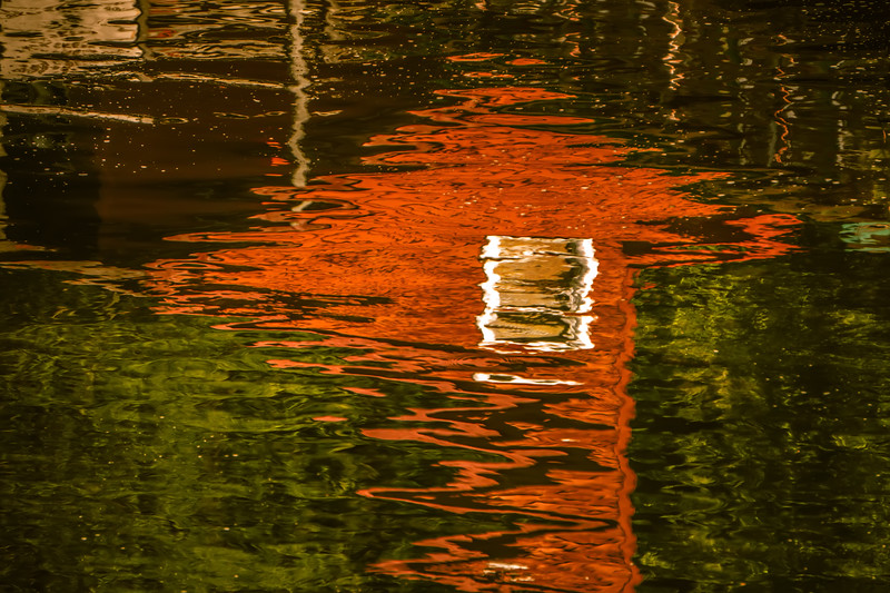 abstract red building and nature reflection in creek