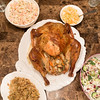 Thanksgiving dinner table with turkey and salads