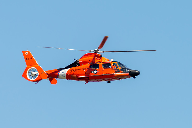 coast guard flying over cooper river bridge in charleston sc