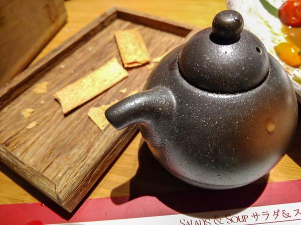 japanese teapot on dining table in restaurant