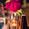 romantic dinner time setup on table with a rose
