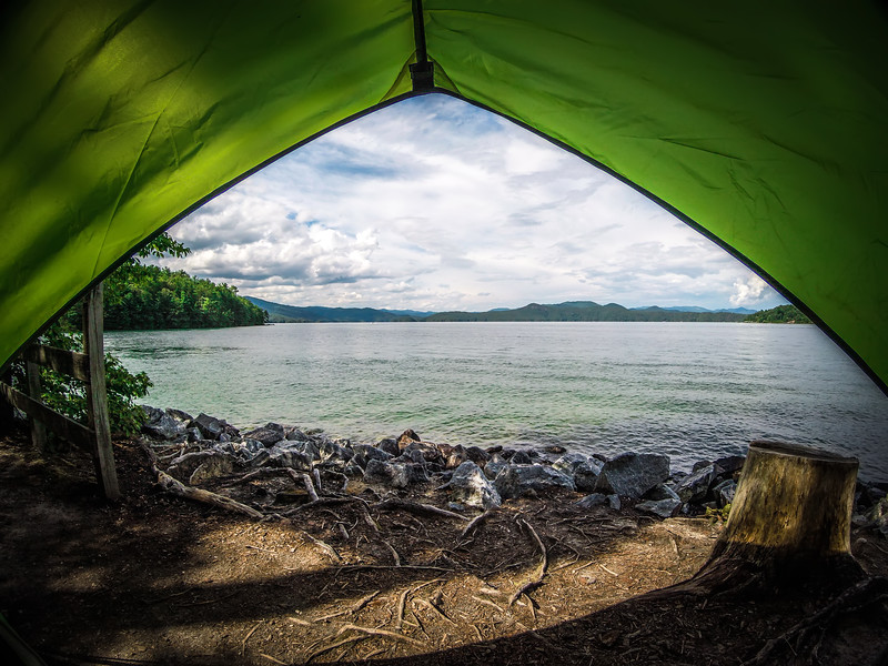 view from tent looking at lake jocassee south carolina in summer