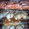 electric smoker loaded with variety of meat