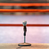 announcer microphone on table before boxing ring