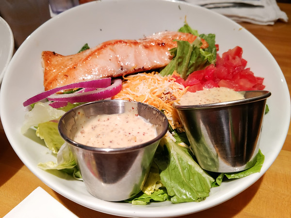 grilled salmon salad on dinner table