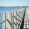 guear rail and security fence along harbor pier in port