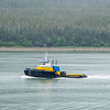 small tug boat on the move at bay in alaska