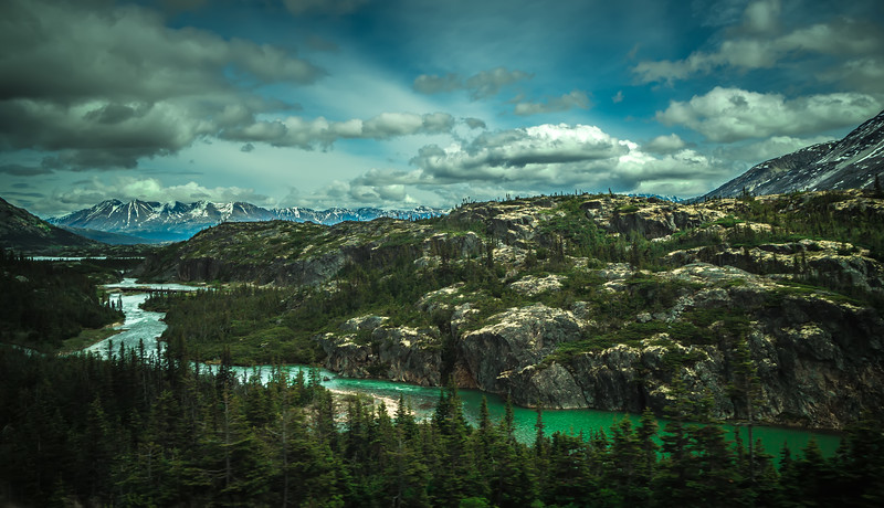 The White Pass and Yukon Route on train passing through vast landscape