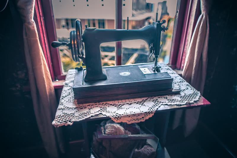 old vintage sewing machine near wunlit window