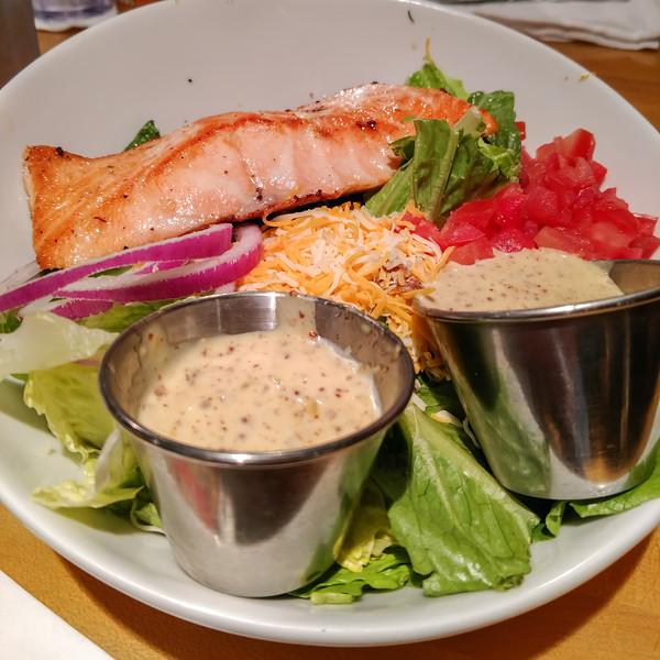 grilled salmon salad on dinner table