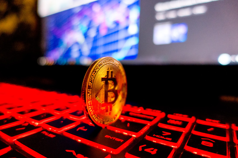 Bitcoin coin l on laptop keyboard