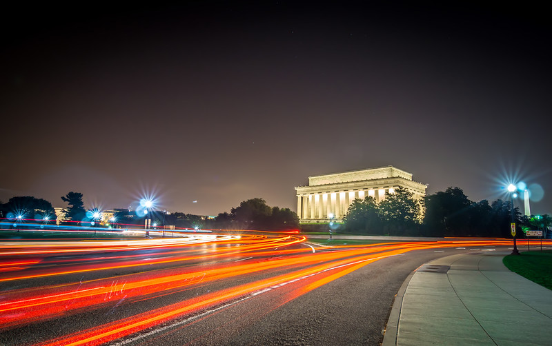 lincoln memorial monument with car trails at night