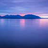 sunset over alaska fjords on a cruise trip near ketchikan