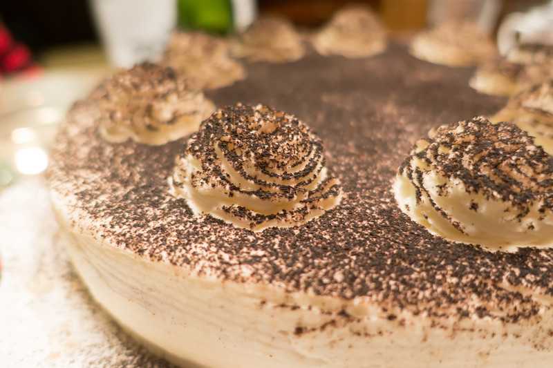 chocolate coffee tiramisu cake on dinner table for a birthday
