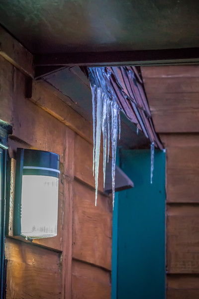 icicles on a wooden structure in winter after snowstorm