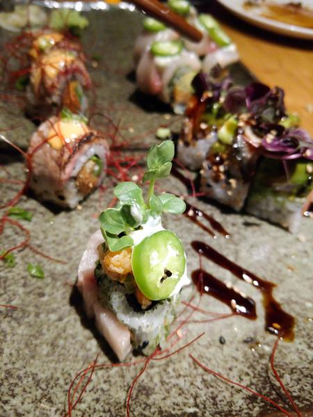 japanese sushi and sushimi on restaurant dinner table
