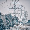 snow covered valley and electric power grid lines