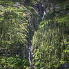 small waterfalls on mountain slopes in alaska mountains