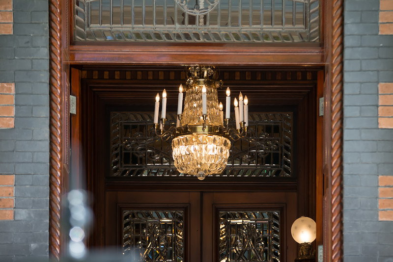 chandelier visible through building entrance
