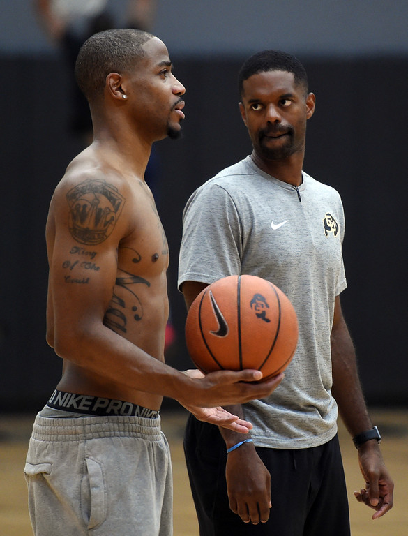. Dominique Coleman, left, and TBT coach, Dwight Thorne II at practice. The 2018 TBT Colorado team was practicing at the CU Events Center on Friday. For more photos, go to buffzone.com. Cliff Grassmick  Staff Photographer  June 29, 2018