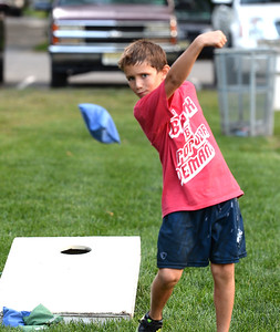 EMMITT WHITING, AGE 9 OF BRIELLE, NEW JERSEY TRIED HIS HAND AT THE CORN HOLE GAME OFFERED AT PICNIC IN THE PARK, IN BRIELLE, NEW JERSEY ON 08/28/2018. (STEVE WEXLER/THE COAST STAR).