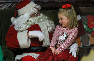 Santa and Faye Hayes, of Avon, talking. The annual town tree lighting event in Avon By the Sea, NJ on 12/2/18. [DANIELLA HEMINGHAUS | THE COAST STAR]