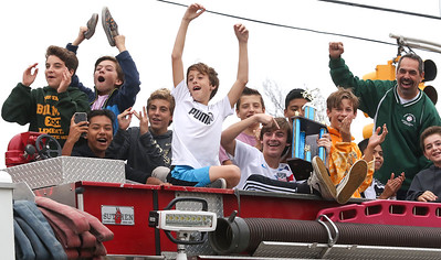 The undefeated Belmar Elementary boys soccer team ridding past the school on firetrucks in Belmar, NJ on 11/2/18. [DANIELLA HEMINGHAUS | THE COAST STAR]