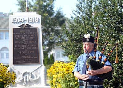 "BAGPIPER BOB PHELAN OF BELMAR PLAYED A SELECTION OF TUNES INCLUDING ""THERE'S NO PLACE LIKE HOME"" DURING THE HOMECOMING OF THE DOUGHBOY STATUE AFTER RESTORATION WAS COMPLETE TO FIX THE VANDALISM DONE LAST YEAR. THE CEREMONY TOOK PLACE AT DOUGHBOY PARK IN BELMAR, NEW JERSEY ON 07/27/2018. (STEVE WEXLER/THE COAST STAR)."