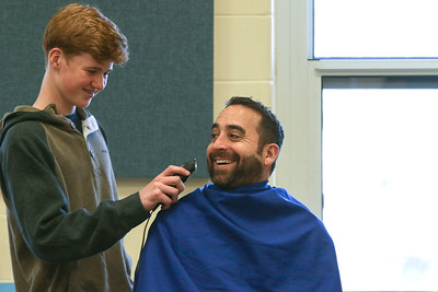 "Principal Christopher Albrizio being shaved by student council president Pat Reilly. Avon Elementary's ""No Shave November"" assembly in Avon By The Sea, NJ on 11/29/18. [DANIELLA HEMINGHAUS 