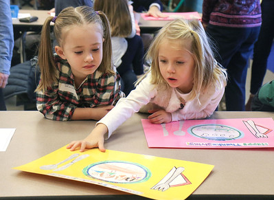 Reagan Roy and her cousin Sadie Child looking at their homemade placemats. The Kindergarten and first graders of Avon elementary celebrating Thanksgiving together in Avon by the Sea, NJ on 11/21/18. [DANIELLA HEMINGHAUS | THE OCEAN STAR]