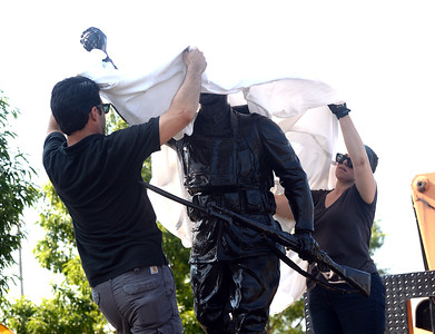WORKERS FROM SEWARD JOHNSON ATELIER OF HAMILTON, NEW JERSEY READY THE DOUGHBOY STATUE FOR INSTALLATION AFTER IT'S RETURN TO DOUGHBOY PARK IN BELMAR, NEW JERSEY AFTER A RESTORATION PROJECT CORRECTED VANDALISM DONE TO IT LAST YEAR. THE CEREMONY TOOK PLACE  IN BELMAR, NEW JERSEY ON 07/27/2018. (STEVE WEXLER/THE COAST STAR).