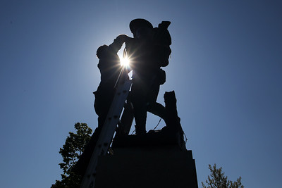 The Doughboy statue located at 10 Avenue in Belmar was removed and taken for restoration by workers from Seward Johnson Atelier on Tuesday May 8, 2018. (MARK R. SULLIVAN/THE COAST STAR)