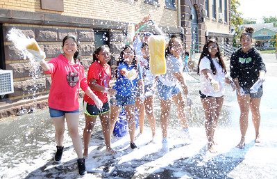 8TH GRADE STUDENTS AT THE BRADLEY BEACH ELEMENTARY SCHOOL IN BRADLEY BEACH, NEW JERSEY HAVING FUN WHILE PARTICIPATING IN THEIR CAR WASH EVENT TO FUND THEIR FUTURE TRIP TO WASHINGTON D.C. THE CAR WASH WAS HELD ON 09/30/2018. (STEVE WEXLER/THE COAST STAR).
