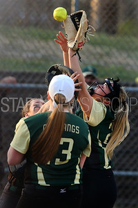 Brick Memorial High School takes on Brick High School in a girls varsity softball game held at Brick Memorial on Friday April 13, 2018. Brick Memorial's # 25 pitcher Jenna Pfizer (right) collides with her catcher (left) Nicole Shea as the both go to grab a pop up hit by Brick's # 6 Corinne Connelly (not seen).  (MARK R. SULLIVAN /THE OCEAN STAR)