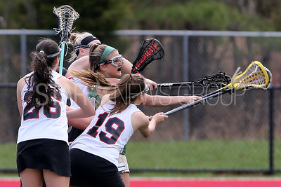 Brick Memorial  High School girls lacrosse take on Jackson Memorial High School at Holman Sports Complex in Jackson  on Monday April 16,2018. Brick Memorial's # 11 (center) Michaella Merklin battles with four Jackson Memorial High School defenders. (MARK R. SULLIVAN /THE OCEAN STAR)