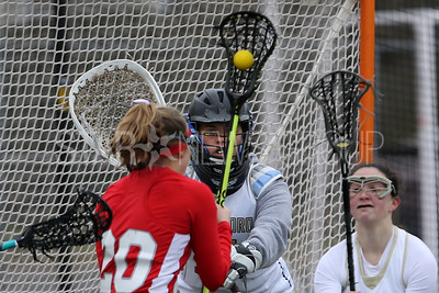 Point Pleasant Borough High School takes on Jackson Memorial High School in a girls varsity lacrosse game in Point Pleasant Borough on Friday April 6, 2018. Here Jordan Vitale (center) Point Pleasant Borough goalie keeps an eye on Jackson Memorial's # 20 (left) Donna Polhemus as she closing in on the goal. (MARK R. SULLIVAN /THE COAST STAR)