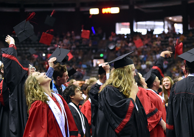 Loveland High School graduates toss their caps during their graduation ceremony Saturday, May 26, 2018, at the Budweiser Events Center at The Ranch in Loveland.   (Photo by Jenny Sparks/Loveland Reporter-Herald)