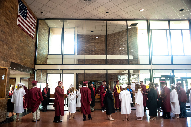 Berthoud High School graduates and teachers line up in the cafeteria before the graduation ceremony on Saturday, May 26 at Berthoud High School.