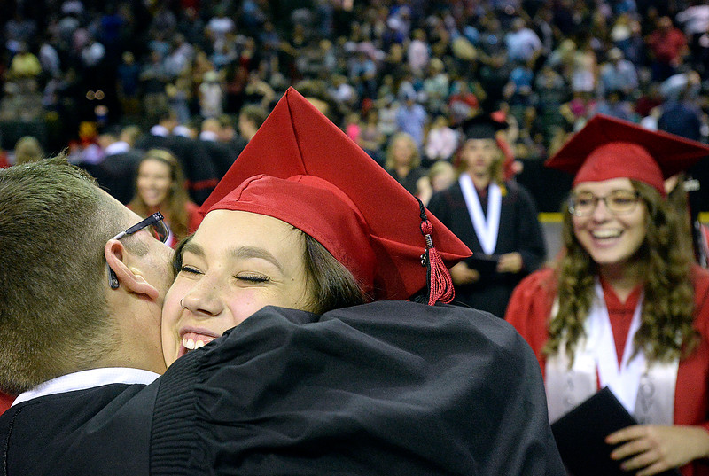 Loveland High School graduates Alex Adkisson, left, and Maddison Rozeski hug and celebrate moments after their graduation ceremony Saturday, May 26, 2018, at the Budweiser Events Center at The Ranch in Loveland.   (Photo by Jenny Sparks/Loveland Reporter-Herald)