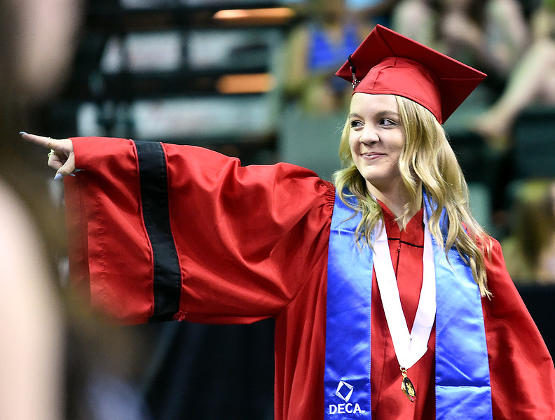 Loveland High School graduate Brianna Mowry points to her family as she enters the arena for her graduation ceremony Saturday, May 26, 2018, at the Budweiser Events Center at The Ranch in Loveland.   (Photo by Jenny Sparks/Loveland Reporter-Herald)