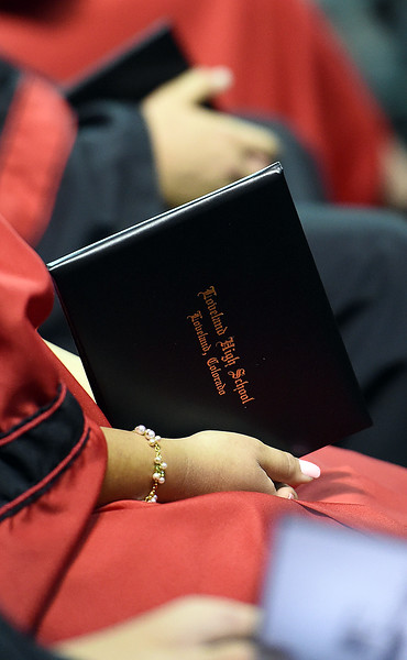 A Loveland High School graduate holds her diploma during her graduation ceremony Saturday, May 26, 2018, at the Budweiser Events Center at The Ranch in Loveland.   (Photo by Jenny Sparks/Loveland Reporter-Herald)